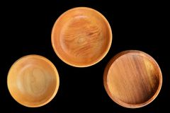 Small wooden bowls isolated on black. Small empty wooden bowls isolated on black background in horizontal format from overhead Royalty Free Stock Image
