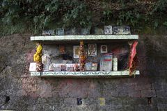 Small encloser which is used by the hindu locals to worship in mahakal road of darjeeling. Small encloser on the road side which is used hindu locals worship stock photo