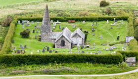 Small English church and grave yard royalty free stock photo