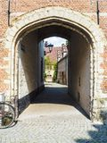 Small entrance gate to a cobblestone alley in the large beguinag. E in Mechelen, Belgium Royalty Free Stock Photography