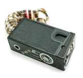 Small espionage photo camera and film. Isolated on a white background Stock Photos