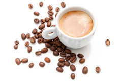 Small espresso cup with coffee beans Royalty Free Stock Photography