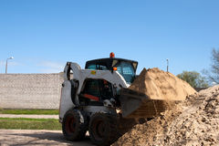 A small excavator Bobcat Stock Photo