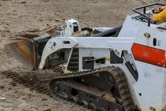 Free Small Excavator Bobcat At Construction Site Skid Loader On Construction Site Stock Photos - 109104063