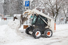 Small excavator bobcat working on the street Stock Photography