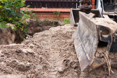 Small excavator Stock Image
