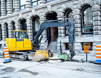 Small excavator in old port Royalty Free Stock Images