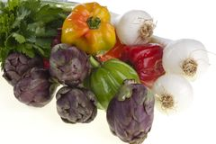 Small exotic peppers and artichokes Stock Images