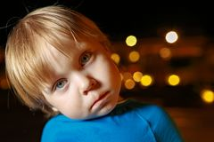 Small fair hair toddler boy in airplane stock image