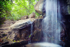 Small falls flow down from stones Stock Photo