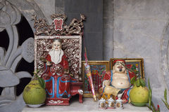 Small family altar. Small buddhist altar with visible influence of chinese culture. It is typical for all countries that were called Indochina in colonial times Stock Image