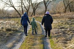 The family goes for a spring walk. A small family goes for a spring walk stock images