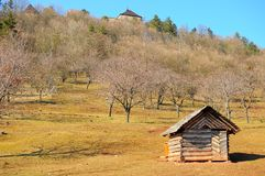 Small farm at the foot of the medieval castle. On a spring day Royalty Free Stock Photo