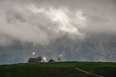 Small farm on mountain background in stormy weather Royalty Free Stock Photos