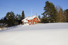 Small farm in winter time, snow and ice Stock Photography