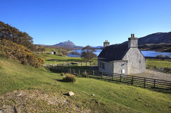 Small farmer's house in Kyle of Tongue area. Traditional Scottish farmer's house in the northern Scotland. Landscape view to the Kyle of Tongue (or Tongue Bay) stock photo