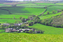 Small Farming Community in England. A person can find beautiful country sides when hiking or even driving through England. The lush green fields and fields ready Royalty Free Stock Photography