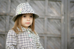 Small fashionable. A small woman of fashion in a checked coat and hat Royalty Free Stock Images
