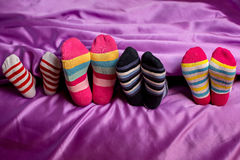 Small feet in colorful socks. Royalty Free Stock Photography