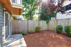 Small fenced backyard with sawdust Royalty Free Stock Photos