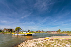 Small ferry crossing the Dutch river IJssel Royalty Free Stock Images