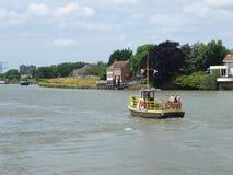 Small ferry over river Hollandsche IJssel between Ouderkerk en Nieuwerkerk aan den IJssel. Small ferry over river Hollandsche IJssel between Ouderkerk en royalty free stock image