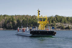 Small ferry passes the machine Royalty Free Stock Photography