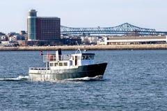 Small ferry sail on Boston Harbor. Across Logan airport stock photos
