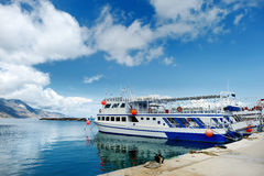 Small ferryboat docked in greek town Royalty Free Stock Images