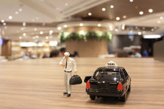 Small figure with the japan taxi Royalty Free Stock Image