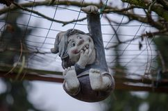 A small figure made of clay, is hanging down Stock Images