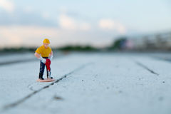 Small figure of a man digging street Royalty Free Stock Images