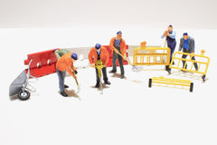 Small figure of  men digging Royalty Free Stock Images