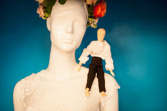 Small figure on the shoulder of dummy in a wreath Royalty Free Stock Image