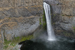 Small figures next to large Palouse Falls royalty free stock photography