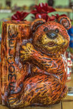 Small figurine Bear with stump Stock Photography