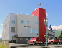 A Small Fire Station Building. With 2 fire vehicles in the front of the station Royalty Free Stock Images