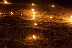 Small fires on meadow during a light celebration in the Frankonian Alb, Southern Germany stock images