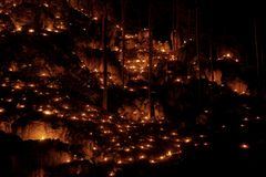 Small fires in a rocky hill with trees during a light celebration in the Frankonian Alb, Southern Germany stock photos