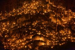 Small fires in a rocky hill with trees during a light celebration in the Frankonian Alb, Southern Germany stock image