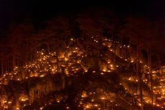 Small fires in a rocky hill with trees during a light celebration in the Frankonian Alb, Southern Germany stock photo
