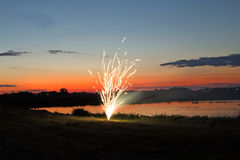 Small fireworks over pond Royalty Free Stock Images