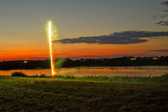 Small fireworks over pond Stock Photos