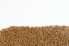 Small Fish feed. On white background Royalty Free Stock Photo
