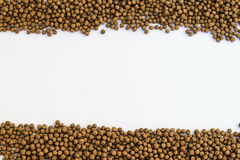Small Fish feed. On white background Royalty Free Stock Photography