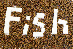 Small Fish feed. On white background Stock Photography