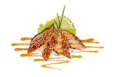 Small fish in sauce. On white background Stock Photos