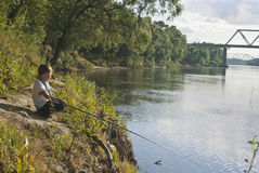 Small fisherman with a rod Royalty Free Stock Photo