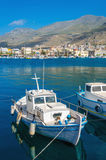 Small fisherman's boat in Greek blue and white colors in Phothia. Port of Kalymnos, Greece Stock Photos