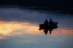Small fishermen ship on a sundown lake Royalty Free Stock Photography